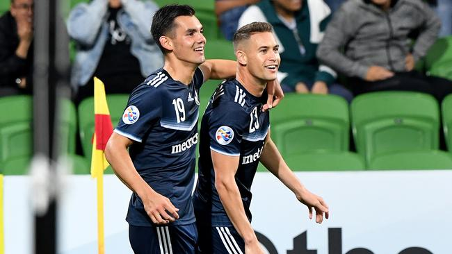 Jai Ingham of Melbourne Victory is congratulated by team mate Pierce Waring (left) after scoring a goal during the AFC Champions League. (AAP Image/Joe Castro)