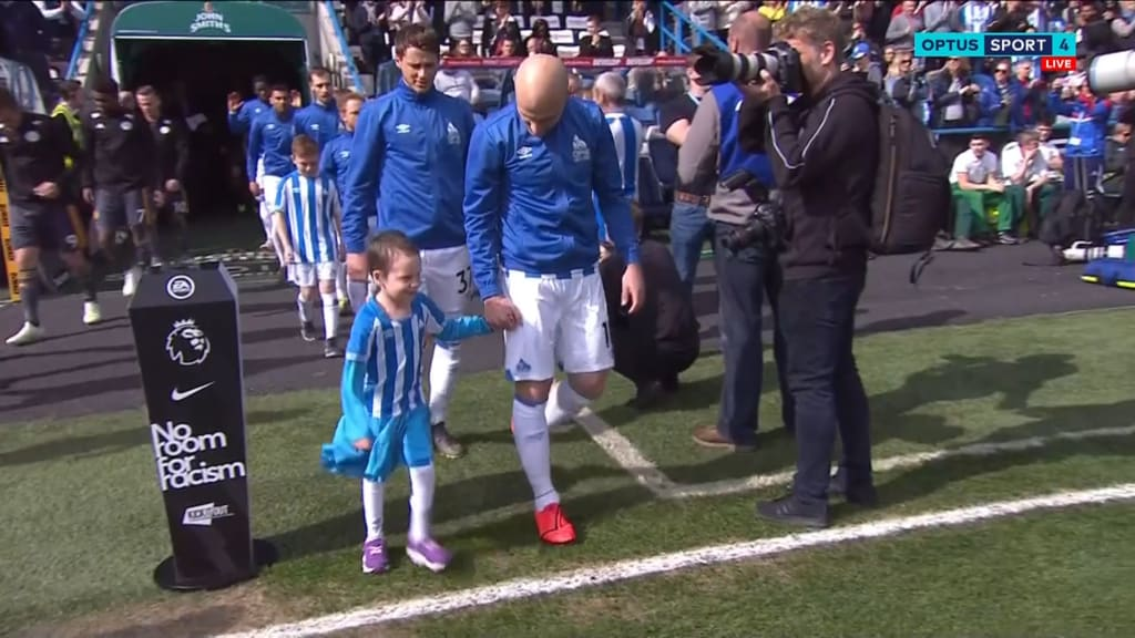 Aaron Mooy and Bella walk out for Huddersfield's clash with Leicester
