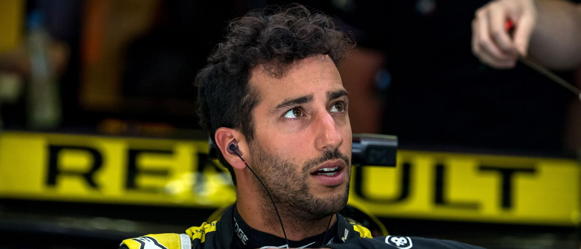 Renault's Australian driver Daniel Ricciardo rests in the paddock during the third practice session ahead of the Formula One Bahrain Grand Prix at the Sakhir circuit in the desert south of the Bahraini capital Manama, on March 30, 2019. - The Formula One Bahrain Grand Prix will be held on March 31. (Photo by Andrej ISAKOVIC / AFP)