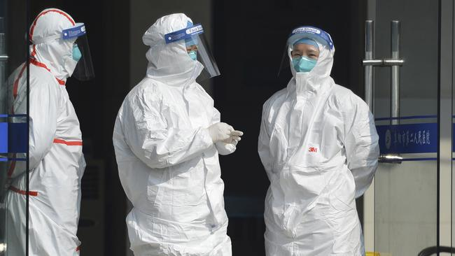 Medical staff in protective outfits treat fever patients from Wuhan in Fuyang in central China's Anhui Province. Picture: Chinatopix via AP)