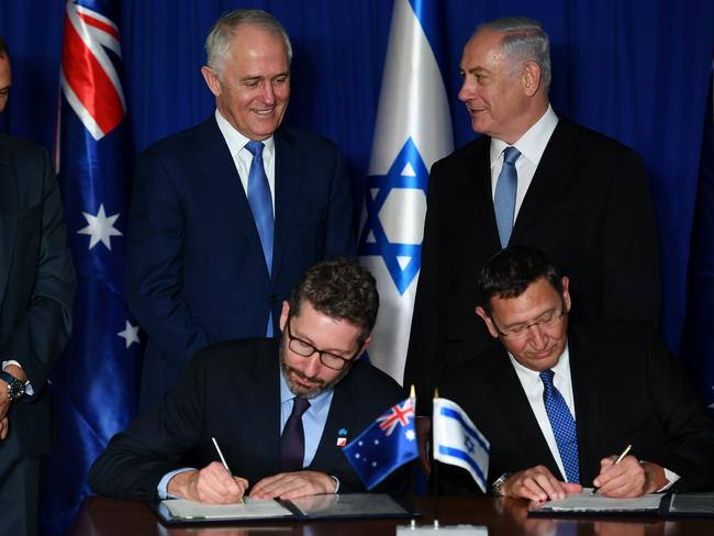 Prime Minister Turnbull and Israeli Prime Minister Netanyahu watch Australian ambassador to Israel Chris Cannan and Director General of the Israeli Ministry of Defence Ehud Adam sign Defence Industries Agreements in Jerusalem. Picture: AAP