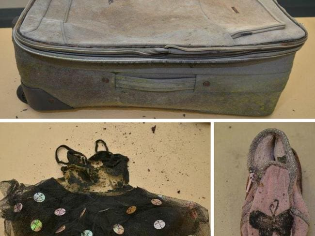 The suitcase and a number of items found inside.