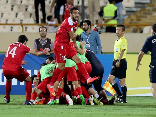 Syria's players celebrate