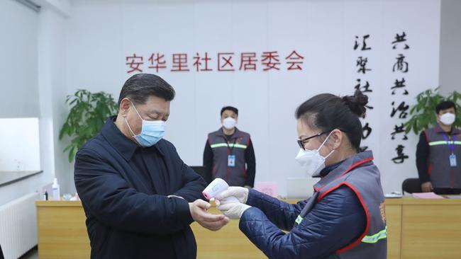 Mr XI had his temperature checked during the inspection. Picture: AP/Xinhua/Ju Peng