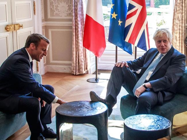 Britain's Prime Minister Boris Johnson casually rests his foot on the table during a meeting with French President Emmanuel Macron at the Elysee Palace in Paris. Picture: AFP