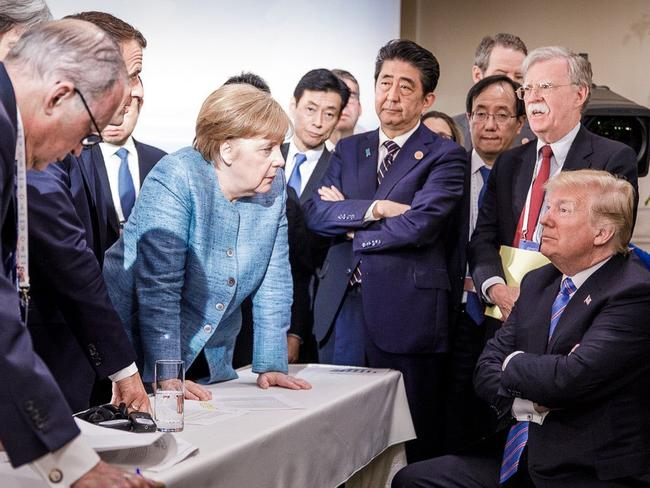 US President Donald Trump talking with German Chancellor Angela Merkel and surrounded by other G7 leaders during a meeting of the G7 Summit in La Malbaie, Quebec, Canada. Picture: AFP/Bundesregierung/Jesco Denzel