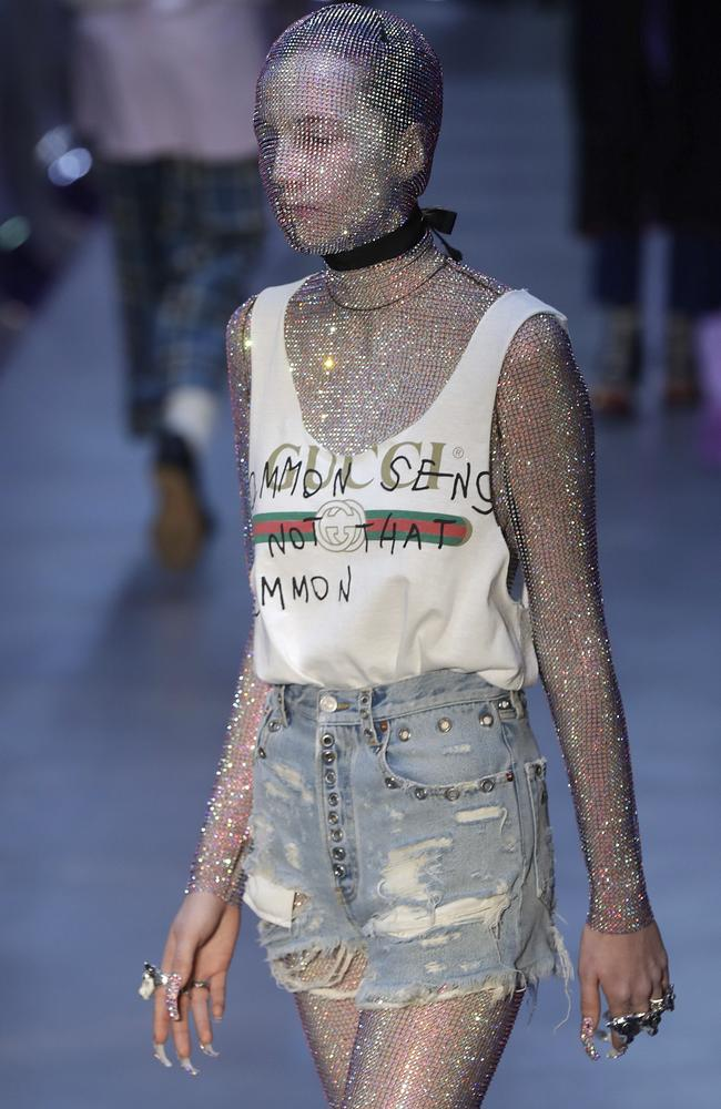 Not a pretty face at Gucci (actually, this model's face isn't even visible through the full body metallic leotard). Picture: AP