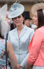Britain's Catherine, Duchess of Cambridge greets guests at a garden party at Buckingham Palace in London on May 16, 2017. Picture: AFP