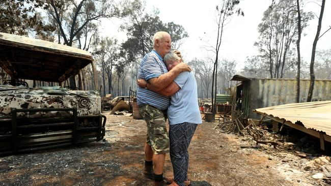 Laurie Campbell and his wife Lyn with what is left of their house destroyed by the bushfires. Picture: Nathan Edwards