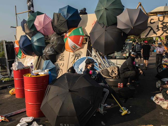 A barricade on a bridge at the Chinese University of Hong Kong (CUHK) festooned with umbrellas. Picture: DALE DE LA REY / AFP.