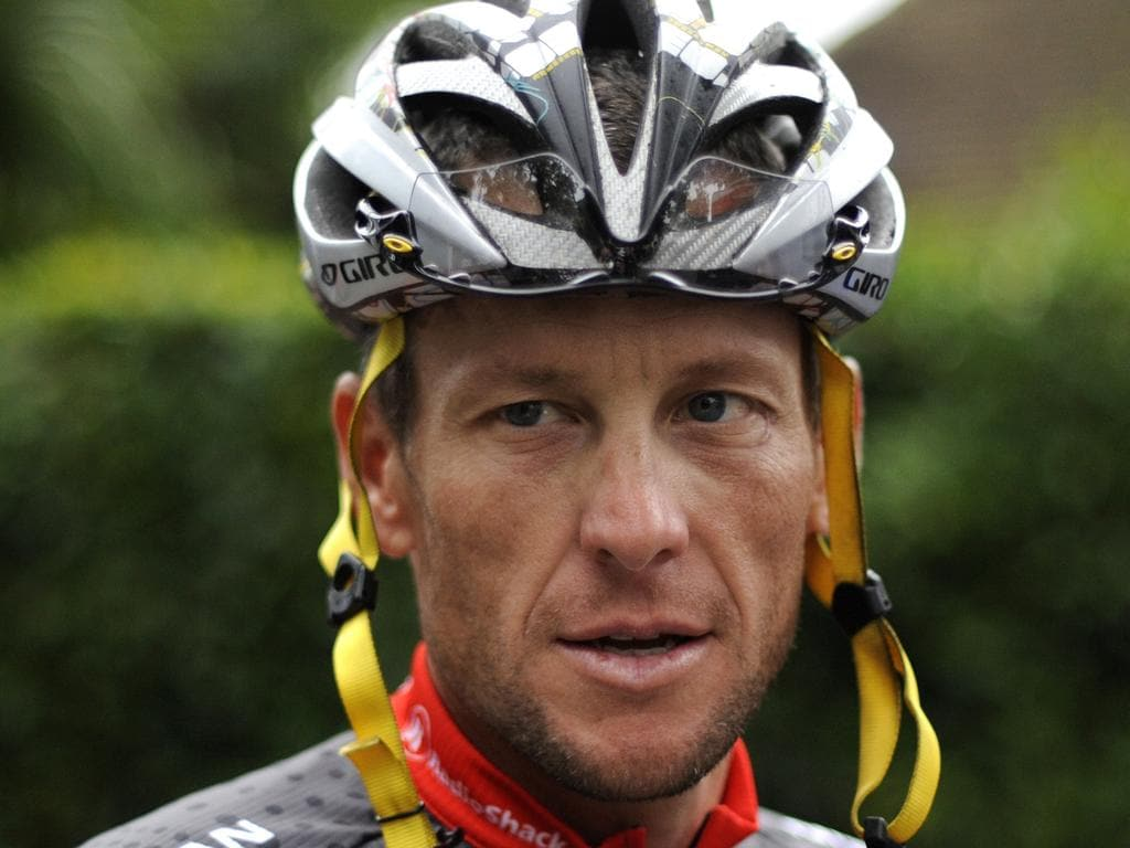 A file photo taken on July 21, 2010 shows US cyclist Lance Armstrong as he arrives to participate in a training session during the second of the two rest days of the 2010 Tour de France cycling race at the hotel hosting the US cycling team in Pau, south west France.  AFP PHOTO / NATHALIE MAGNIEZ / AFP PHOTO / NATHALIE MAGNIEZ