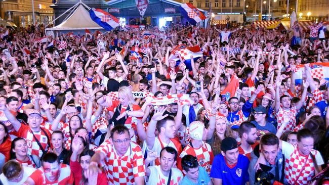 Croatia's supporters celebrate after winning the Russia 2018 World Cup semi-final football match between Croatia and England.