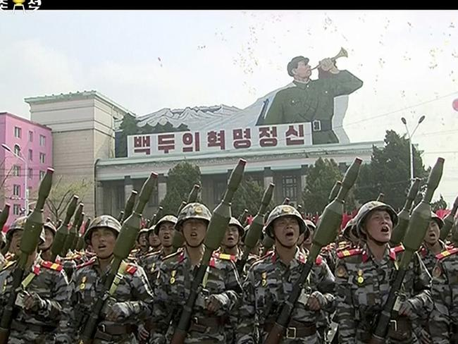 In this image made from video broadcast by North Korean broadcaster KRT, soldiers take part in a parade at Kim Il Sung Square in Pyongyang.