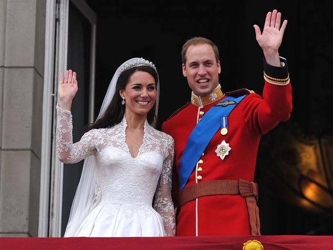 Prince William and his wife Kate, Duchess of Cambridge, wave to the crowd from the balcony of Buckingham Palace in London following their wedding. Picture: AFP