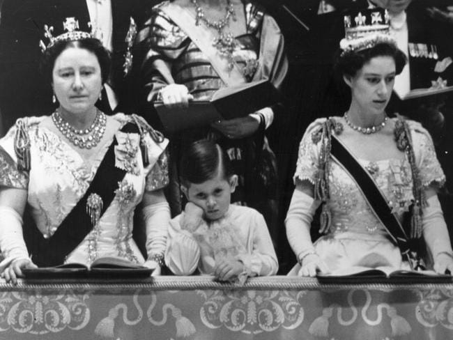 Prince Charles (centre, with the Queen Mother, left, and Princess Margaret, right) at his mother's 1953 coronation ceremony, which despite his glumness was a joyous occasion. Picture: Topical Press Agency.
