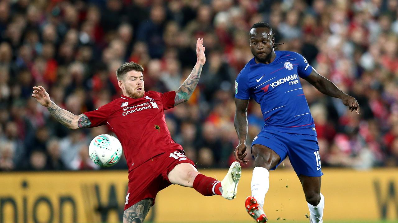 Victor Moses of Chelsea is challenged by Alberto Moreno of Liverpool