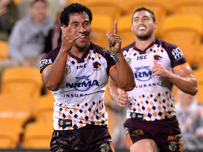 Tautau Moga celebrates for the Broncos.