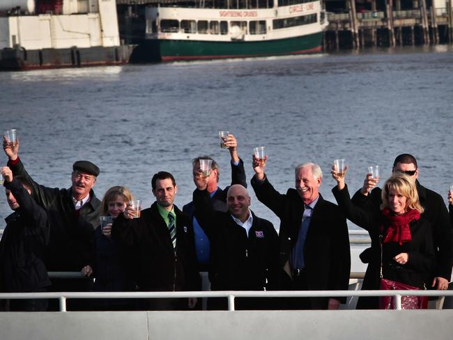 "Captain Chesley ""Sully"" Sullenberger III, third from right, pilot who safely glided US Airways Flight 1549 with 155 passengers and crew to a water landing joins survivors and rescuers in a toast marking the anniversary of the event known as the ""miracle on the Hudson"". Picture: AP"