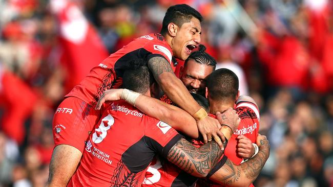 Tonga celebrates during the 2017 Rugby League World Cup match between the New Zealand Kiwis and Tonga at Waikato Stadium.