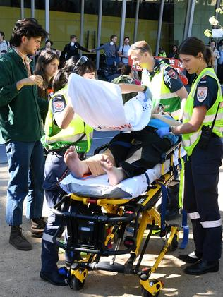 A female protester was hospitalised. Picture: James Ross/AAP