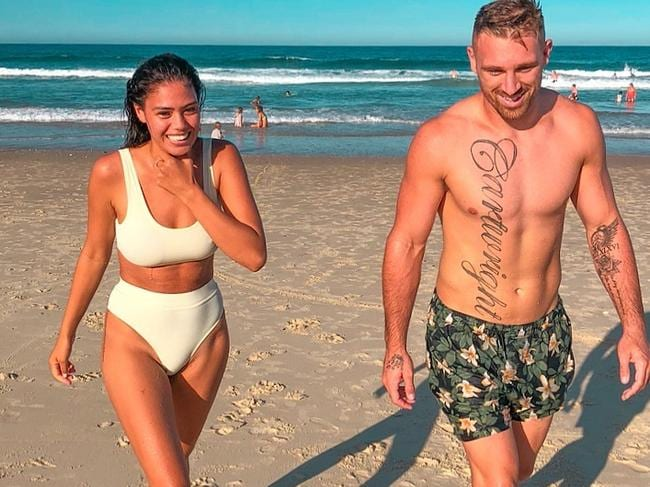 Bryce Cartwright with partner Shanelle Cartwright. Ms Cartwright has reportedly had her Instagram affected by changes made to thwart anti-vaxxer disinformation.
