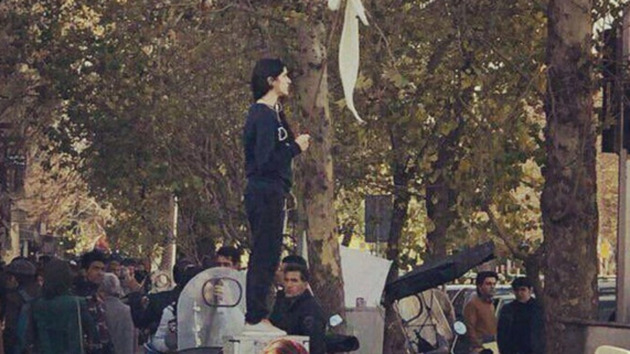 Lone Woman Unveils Silent Protest To Irans Mullahs