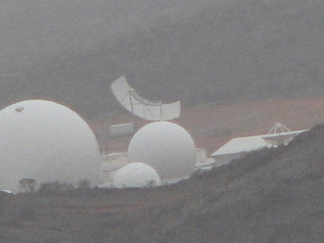 A long-distance view of Pine Gap showing the multi-beam antennas, known as Torus, which can simultaneously intercept up to 35 satellite communications beams. Picture: Richard Tanter, Nautilus Institute