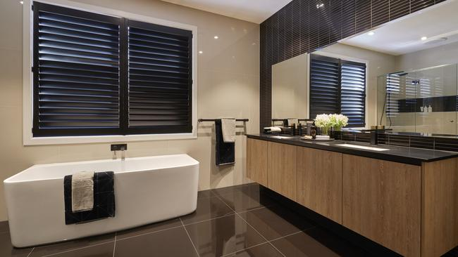 Textured cabinetry combines with black stone.
