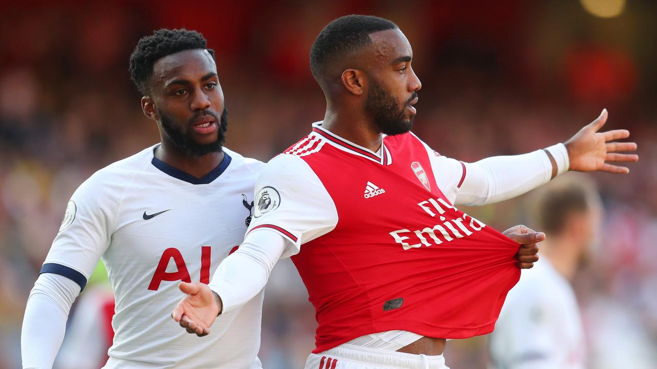 Alexandre Lacazette of Arsenal (R) will miss three matches. (Photo by Catherine Ivill/Getty Images)