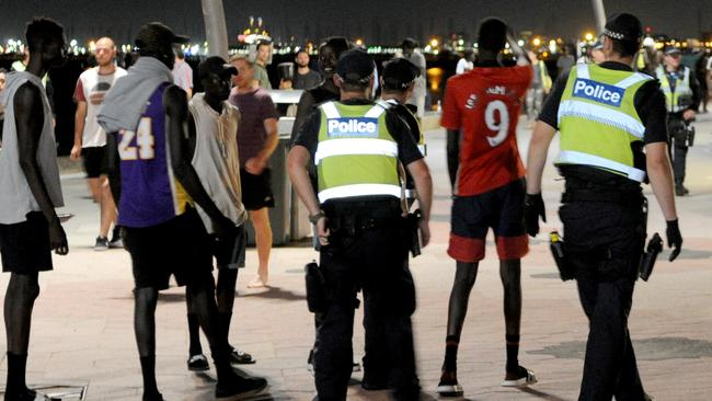 There was a strong police presence at St Kilda Beach last night after recent violent incidents in the area. Picture: Andrew Henshaw