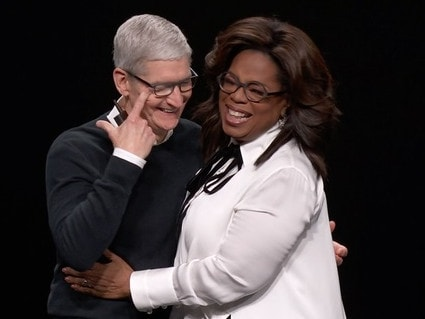 Tim Cook sheds a tear as he hugs Oprah.
