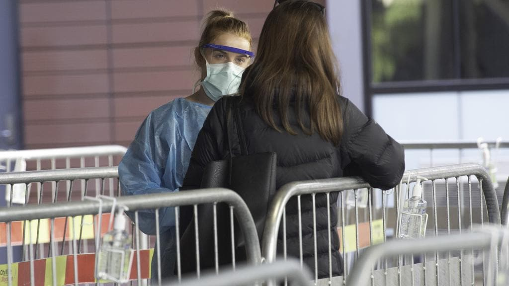 A woman is tested for coronaviruses at Royal Melbourne Hospital. Image: Tony Gough