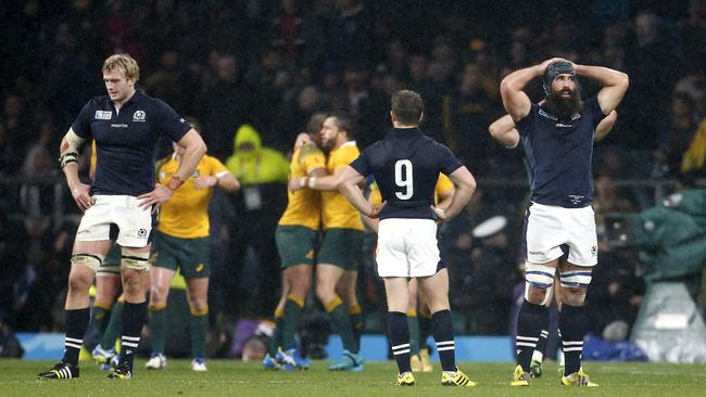 A dejected Richie Gray, Greig Laidlaw and Josh Strauss following their Rugby World Cup loss.