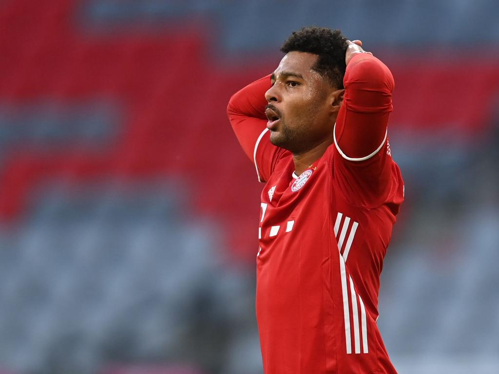 (FILES) In this file photo taken on October 4, 2020 Bayern Munich's German midfielder Serge Gnabry reacts during the German first division Bundesliga football match FC Bayern Munich vs Hertha Berlin in Munich, southern Germany. - Bayern Munich's German midfielder Serge Gnabry has tested positiv for Covid-19 the club reported on October 20, 2020. (Photo by CHRISTOF STACHE / AFP) / DFL REGULATIONS PROHIBIT ANY USE OF PHOTOGRAPHS AS IMAGE SEQUENCES AND/OR QUASI-VIDEO