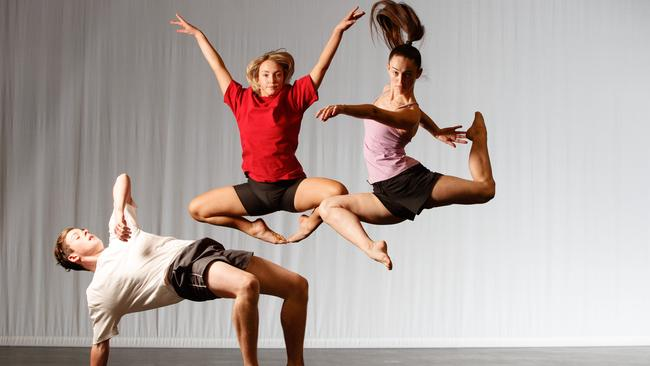 Aspen Palmer, right, is flexible with money and dance, like fellow Australian Dance Theatre Youth Ensemble members Liam Herron and Grace Bosward. Picture MATT TURNER.