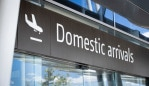 PERTH, AUSTRALIA - JANUARY 08: A general view of a Domestic arrivals sign at Perth Airport on January 8, 2021 in Perth, Australia. The international arrival cap has been lowered and all domestic and international air travellers are now required to wear masks as Australia takes precautions due to concerns over a new Covid-19 strain. Brisbane will enter a three-day lockdown tonight after a cleaner working at a quarantine hotel tested positive for the new Covid-19 variant. (Photo by Matt Jelonek/Getty Images)