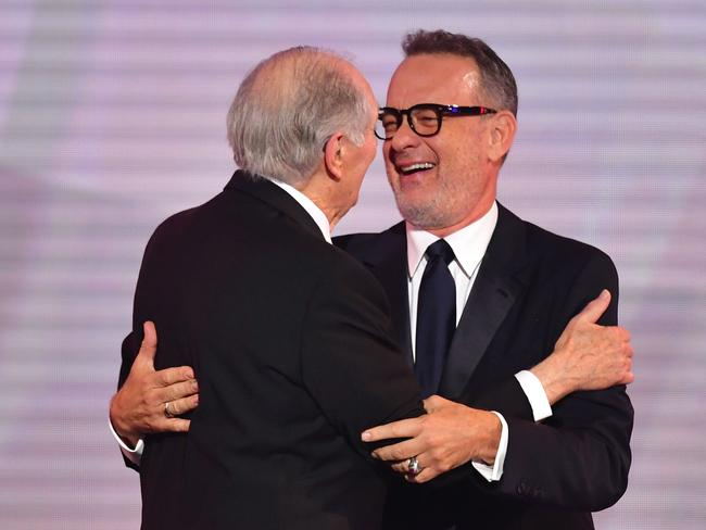 Actor Tom Hanks presents the SAG Life Achievement Award for career achievement and humanitarian accomplishment to actor Alan Alda. Picture: AFP