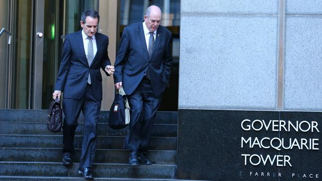 Francis Sullivan (left), chief executive of the Catholic Church's Truth, Justice and Healing Council with Father Brian Lucas (right) former general secretary of the Australian Catholic Bishops Conference, leaves Governor Macquarie Tower in Sydney with his lawyer after appearing on the stand at the Royal Commission into Institutional Responses to Child Sexual Abuse. Picture: Britta Campion/The Australian