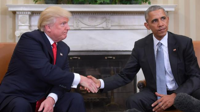 Donald Trump and Barack Obama shake hands during a transition planning meeting at the White House. Picture: Jim Watson/AFP