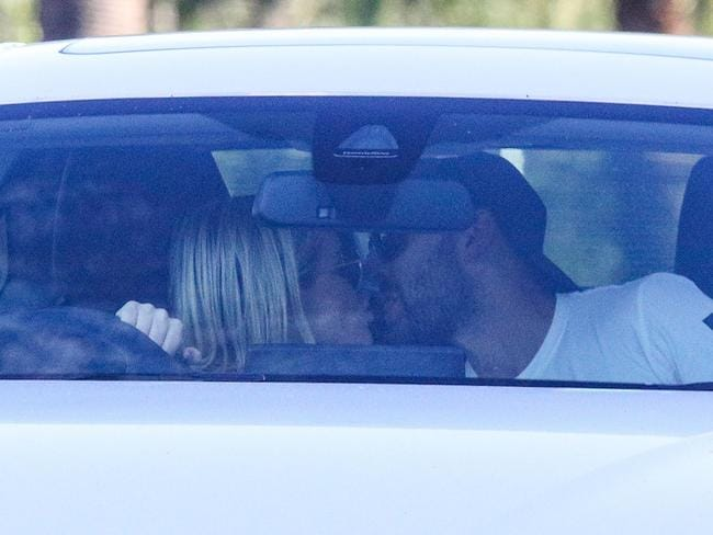 Nathan Lyon and Emma McCarthy were photographed kissing in car before the start of the third Ashes Test in Perth. Picture: BackGrid