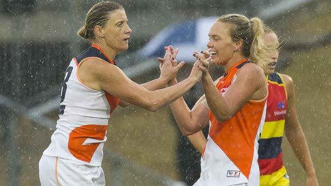 Cora Staunton celebrates a goal in the wet.