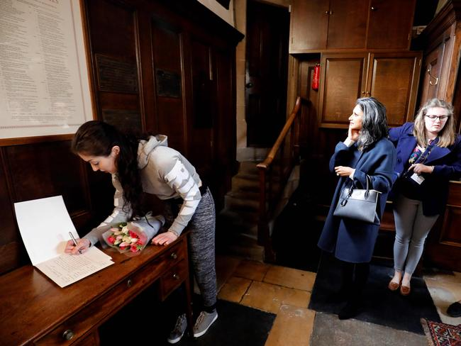 A woman signs a book of condolence book at Gonville and Caius College at Cambridge University, where British physicist, Stephen Hawking was a fellow for over 50 years. Picture: AFP Photo/Tolga Akmen