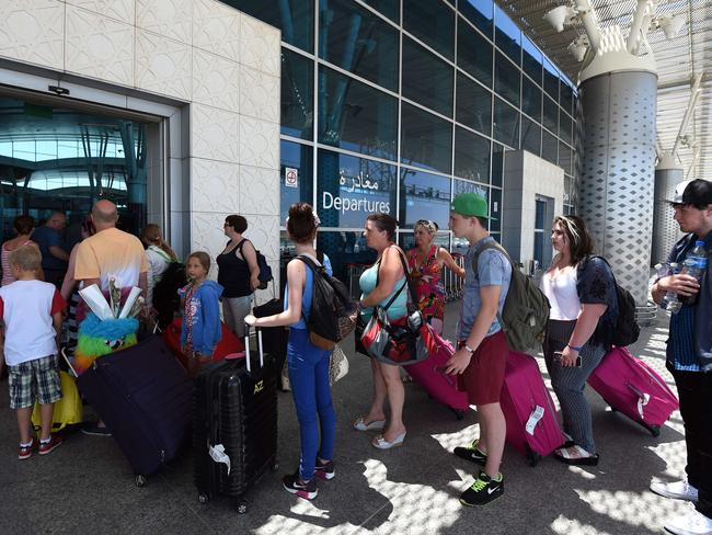British tourists depart from Enfidha International airport after the attack.