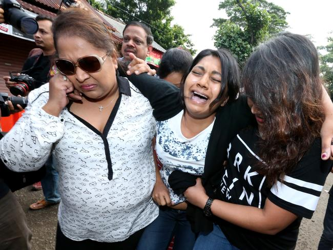 Brintha breaks down as she arrives at Nusa Kambangan port to visit her brother for the last time before the executions. Picture: Adam Taylor