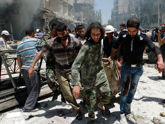 Rescuers carry a body after Syrian regime helicopters allegedly dropped barrel bombs on the Sukkari neighbourhood, an opposition-held district in the northern Syrian city of Aleppo.