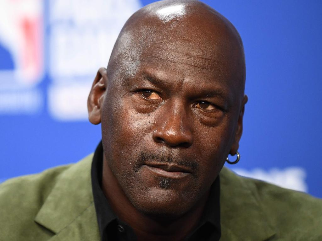 (FILES) In this file photo taken on January 24, 2020 former NBA star and owner of Charlotte Hornets team Michael Jordan looks on as he addresses a press conference ahead of the NBA basketball match between Milwaukee Bucks and Charlotte Hornets at The AccorHotels Arena in Paris. - Michael Jordan said June 5, 2020, he is making a record $100 million donation to groups fighting for racial equality and social justice amid a wave of protests across the United States. (Photo by FRANCK FIFE / AFP)