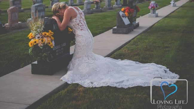 Jessica Padgett at the grave of killed fiance Kendall James Murphy, on what was meant to be their wedding day. Picture: Loving Life Photography
