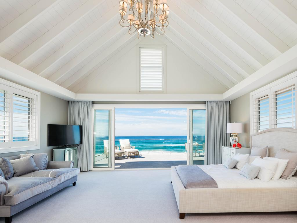 "<span class=""h2"">MAIN BEACH </span>3535 Main Beach Pde, Main Beach PRICE: $6.5 million SOLD: August 5, 2015 AGENT: David Vertullo, Professionals Vertullo Real Estate WITH a mix of natural finishes including marble and timber, this four-storey home has been crafted to create a luxurious lifestyle. There is private access to the beach via a rear gate as well as a 27m heated lap pool, outdoor spa and sauna. A chrome and glass lift services all floors while timber shutters and integrated cabinetry ensure it is a functional property. The floor plan offers separate living, work, entertaining and sleeping zones and incorporates multiple living areas, media room, four ensuited bedrooms, basement parking, gymnasium, wine cellar and two studies. With stunning panoramic views of the ocean, the opulent master bedroom occupies the entire top level."