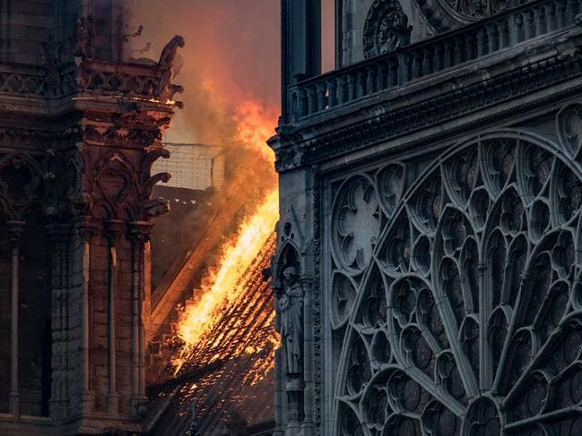 Many are awaiting to hear how damaged the famous rose windows are. Picture: Thomas Samson/AFP