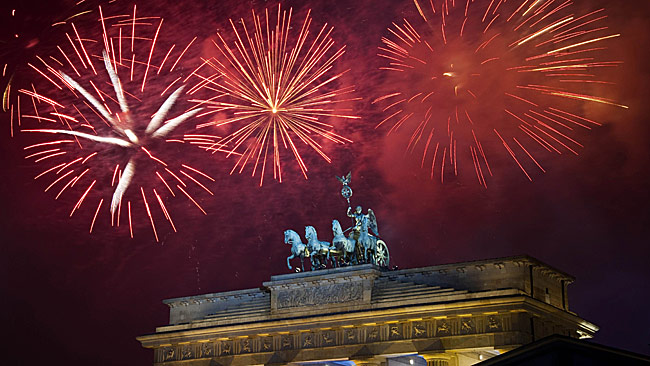 Fireworks explode over the Quadriga statue atop the Brandenburg Gate on New Year's Eve in Berlin, Germany. Picture: Getty Images